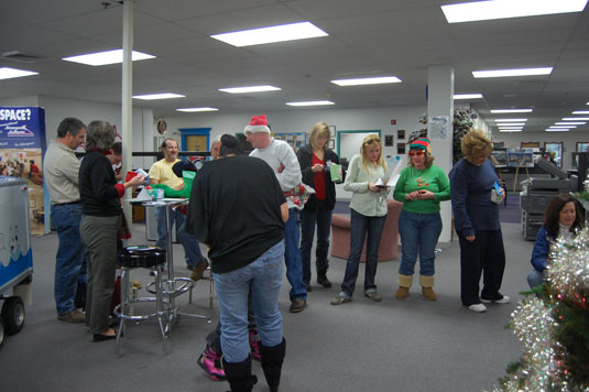 Employees of Basement Systems excited for Secret Santa